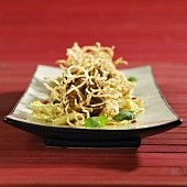 Deep-fried meatballs with glass noodles on Chinese cabbage