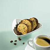 Almond biscuits with coffee beans and a cup of coffee
