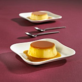 Crème caramel on two plates