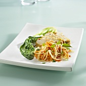 Chicken breast with herb and nut crust and papaya salad