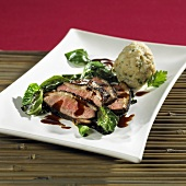 Crispy duck breast with balsamic reduction, bread dumpling