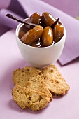 Dates in vanilla syrup with biscotti