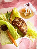 Fried goose liver on young savoy cabbage with carrots