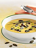 Pumpkin soup with pumpkin seed oil and chives