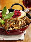 Venison and mushroom ragout and pears with cranberries