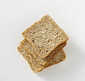 Four slices of wholemeal bread, stacked