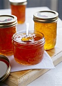 Different kinds of marmalade in jam jars