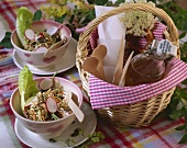 Cabbage salad on a picnic cloth with basket