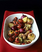 Baked onions, tomatoes, potatoes & apples in serving dish