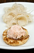 Blini with smoked salmon cream and pickled fennel