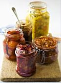 Relishes and pickled vegetables in preserving jars