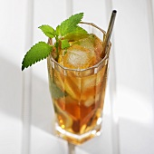 A glass of mint tea with ice cubes