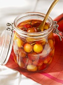 Cherries in alcohol in a preserving jar