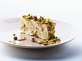 Slice of halva (Sweet made with sesame oil & pistachios, Middle East)