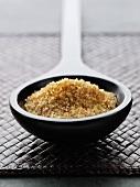 Demerara sugar in a scoop