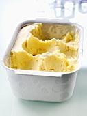 Vanilla ice cream in a container