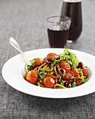 Wholemeal spaghetti with cocktail tomatoes and pea pesto