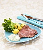 Roast beef with potatoes and dill sauce