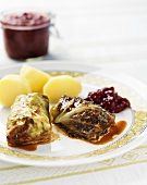 Cabbage leaves with mince stuffing, potatoes, cranberries