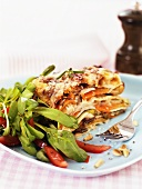 Vegetable lasagne with tomatoes and corn salad