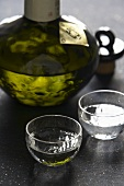 Sake in a glass carafe and two glasses