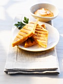 Grilled polenta slices with cocktail sauce