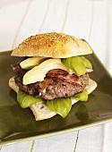 Burger with bacon, basil and avocado