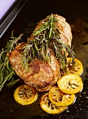 Roast lamb with rosemary and lemons for Easter