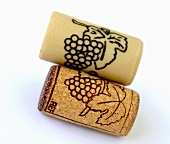 One real cork and one plastic cork