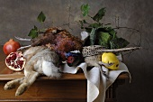 Autumnal hunting still life with game, fruit & vegetables