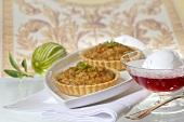 Almond cream tarts, pomegranate dessert with lime ice cream