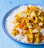 Fish and vegetable curry on rice