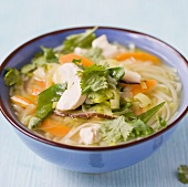 Rice noodle soup with chicken and vegetables