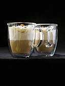Eiskaffee (iced coffee drink) with brown sugar in two glass cups