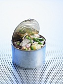 Matjes herring, potato and bean salad in a tin