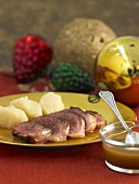 Roast duck breast with honey cognac sauce & celeriac puree