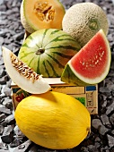 Assorted whole melons and melon wedges