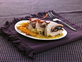 Pork fillet stuffed with bacon and prunes, carrots