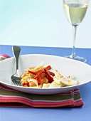 Squid with red pepper and onion salad