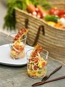 Piperade with fried bacon in two glasses
