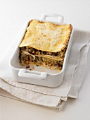 Aubergine and chicken lasagne in a roasting dish