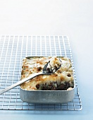 Hachis Parmentier with hazelnuts in a roasting tin