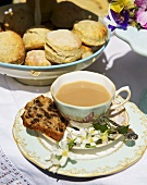 Scones and fruit loaf with a cup of tea