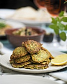 Courgette cakes with lemon wedges