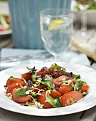 Tomato salad with mung beans sprouts and basil