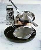 Frying pan, saucepan, baking dish, sieve and grater