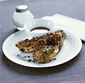 Pork ribs in pepper crust with soy sauce