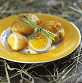 Boiled eggs fried in batter with chives for Easter