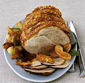 Roast pork with crackling with apples and sage
