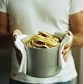 Man holding a pan of spaghetti vongole